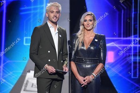 G-Eazy, left, and Charlotte Flair present the award for best college athlete at the ESPY Awards at the Microsoft Theater, in Los Angeles