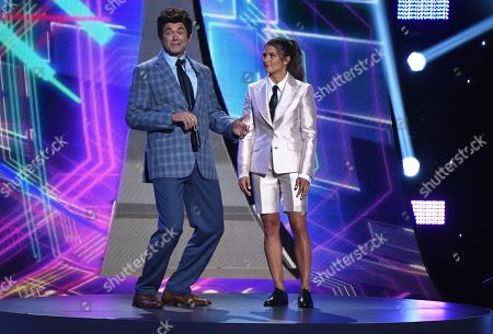 John Michael Higgins, left, and Danica Patrick appear at the ESPY Awards at the Microsoft Theater, in Los Angeles