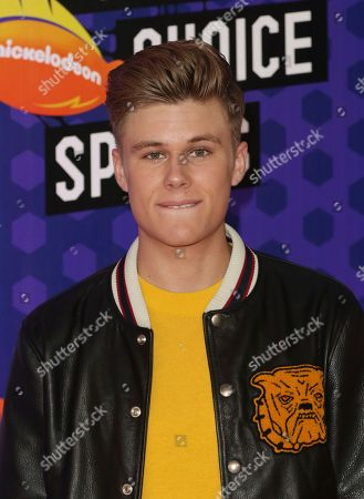 Owen Joyner arrives at the Kids' Choice Sports Awards at the Barker Hangar, in Santa Monica, Calif