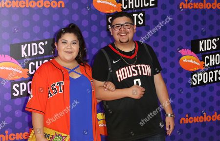 Rico Rodriguez, right, and Raini Rodriguez arrive at the Kids' Choice Sports Awards at the Barker Hangar, in Santa Monica, Calif