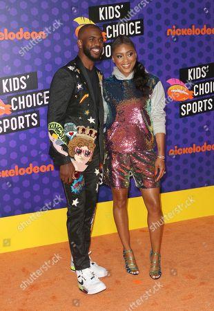 Host Chris Paul, left, and Jada Crawley arrive at the Kids' Choice Sports Awards at the Barker Hangar, in Santa Monica, Calif