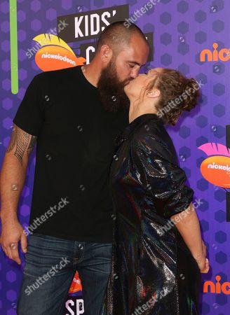 Ronda Rousey, right, and Travis Browne kiss at the Kids' Choice Sports Awards at the Barker Hangar, in Santa Monica, Calif