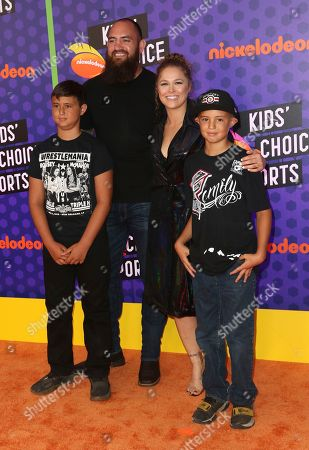 Ronda Rousey, from second right, Travis Browne arrive at the Kids' Choice Sports Awards at the Barker Hangar, in Santa Monica, Calif