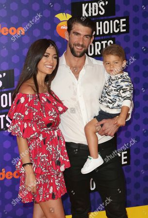 Swimmer Michael Phelps, center, Nicole Johnson, from left, and Boomer Phelps arrive at the Kids' Choice Sports Awards at the Barker Hangar, in Santa Monica, Calif