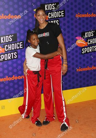 WNBA basketball player Candace Parker, of the Los Angeles Sparks, right, and Lailaa Williams arrive at the Kids' Choice Sports Awards at the Barker Hangar, in Santa Monica, Calif