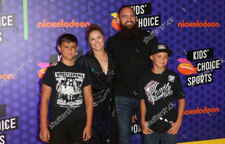 Ronda Rousey, from second left, Travis Browne arrive at the Kids' Choice Sports Awards at the Barker Hangar, in Santa Monica, Calif