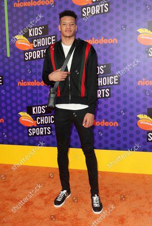 NBA basketball player Kevin Knox, of the New York Knicks, arrives at the Kids' Choice Sports Awards at the Barker Hangar, in Santa Monica, Calif