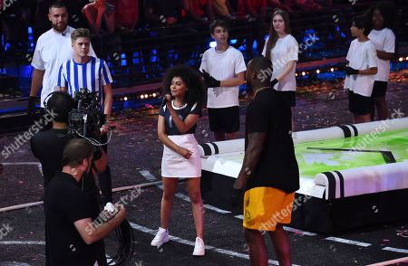 Former NFL player Martellus Bennett, right, and Daniella Perkins appear at the Kids' Choice Sports Awards at the Barker Hangar, in Santa Monica, Calif