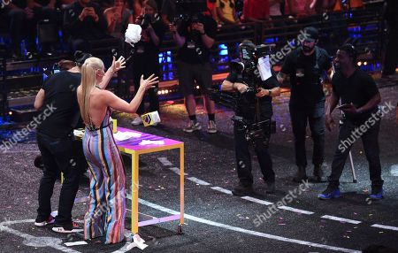 Skier Lindsey Vonn, right, and wrestler Roman Reigns appear at the Kids' Choice Sports Awards at the Barker Hangar, in Santa Monica, Calif