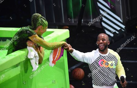 WNBA basketball player Candace Parker of the Los Angeles Sparks, left, and host Chris Paul present the award for best cannon at the Kids' Choice Sports Awards at the Barker Hangar, in Santa Monica, Calif