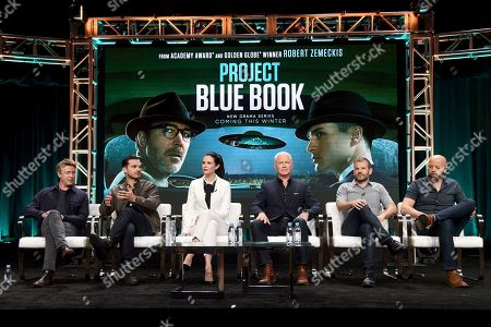 "Aidan Gillen, from left, Michael Malarkey, Laura Mennell, Neal McDonough, creator/writer David O'Leary and Sean Jablonski, show runner/executive producer/writer, participate in History's ""Project Blue Book"" panel during the National Geographic Television Critics Association Summer Press Tour at The Beverly Hilton hotel, in Beverly Hills, Calif"