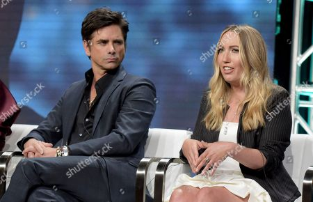 """John Stamos, left, and author Caroline Kepnes participate in Lifetime's """"YOU"""" panel during the Television Critics Association Summer Press Tour at The Beverly Hilton hotel, in Beverly Hills, Calif"""