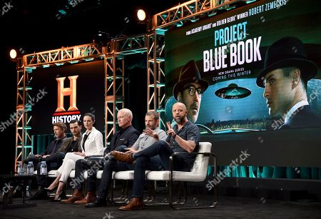 """Aidan Gillen, from left, Michael Malarkey, Laura Mennell, Neal McDonough, creator/writer David O'Leary and Sean Jablonski, show runner/executive producer/writer, participate in History's """"Project Blue Book"""" panel during the National Geographic Television Critics Association Summer Press Tour at The Beverly Hilton hotel, in Beverly Hills, Calif"""