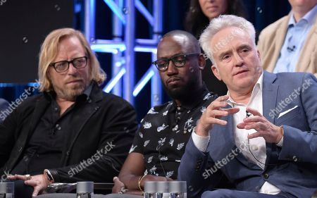 """Showrunner/director/writer Matthew Carnahan, from left, Lamorne Morris and Bradley Whitford participate in the """"Valley of the Boom"""" panel during the National Geographic Television Critics Association Summer Press Tour at The Beverly Hilton hotel, in Beverly Hills, Calif"""