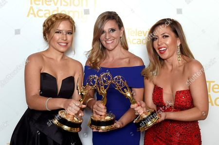"""Stock Image of Elva Saray, from left, Amaya Pinto Fernandez, and Stephanie Himonidis from KVEA pose with the Emmy for informational series (more than 50% studio) for """"Mujeres Que Rompen Estereotipos"""" at the 70th Los Angeles Area Emmy Awards, at the Saban Media Center at Television Academy's North Hollywood, Calif. headquarters on"""