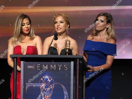 """Stock Photo of Stephanie Himonidis, from left, Elva Saray, and Amaya Pinto Fernandez from KVEA accept the Emmy for informational series (more than 50% studio) for """"Mujeres Que Rompen Estereotipos"""" at the 70th Los Angeles Area Emmy Awards, at the Saban Media Center at Television Academy's North Hollywood, Calif. headquarters on"""