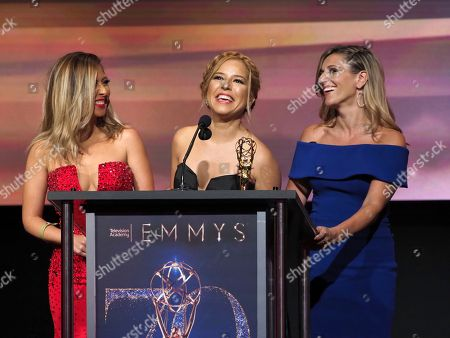 """Stock Picture of Stephanie Himonidis, from left, Elva Saray, and Amaya Pinto Fernandez from KVEA accept the Emmy for informational series (more than 50% studio) for """"Mujeres Que Rompen Estereotipos"""" at the 70th Los Angeles Area Emmy Awards, at the Saban Media Center at Television Academy's North Hollywood, Calif. headquarters on"""