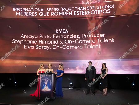 """Stephanie Himonidis, from left, Elva Saray, and Amaya Pinto Fernandez from KVEA accept the Emmy for informational series (more than 50% studio) for """"Mujeres Que Rompen Estereotipos"""" at the 70th Los Angeles Area Emmy Awards, at the Saban Media Center at Television Academy's North Hollywood, Calif. headquarters on"""