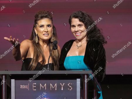 Naibe Reynoso, left, and Anna Marcos Maganini speak at the 70th Los Angeles Area Emmy Awards, at the Saban Media Center at Television Academy's North Hollywood, Calif. headquarters on