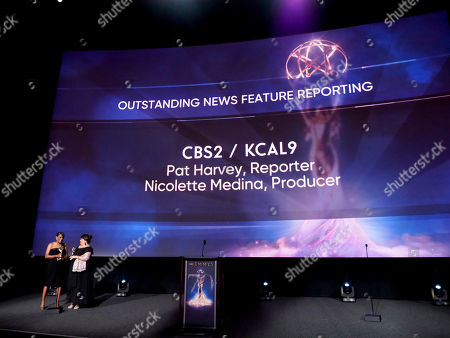 Pat Harvey, left, and Nicolette Medina from CBS2/KCAL9 accept the Emmy for outstanding news feature reporting at the 70th Los Angeles Area Emmy Awards, at the Saban Media Center at Television Academy's North Hollywood, Calif. headquarters on
