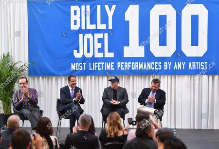 Stock Photo of Actor Chazz Palminteri, left, New York Governor Andrew Cuomo, musician Billy Joel and The Madison Square Garden Company executive chairman and CEO James L. Dolan participate in a press conference to celebrate Billy Joel's 100th lifetime concert at Madison Square Garden on in New York
