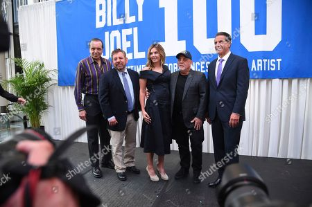 Stock Image of Actor Chazz Palminteri, left, The Madison Square Garden Company executive chairman and CEO James L. Dolan, left, Billy Joel's wife Alexis Roderick, Billy Joel and New York Governor Andrew Cuomo pose together during a press conference to celebrate Billy Joel's 100th lifetime concert at Madison Square Garden on in New York