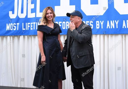 Musician Billy Joel and his wife Alexis Roderick pose together after a press conference to celebrate Billy Joel's 100th lifetime concert at Madison Square Garden on in New York