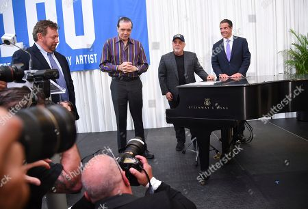 The Madison Square Garden Company executive chairman and CEO James L. Dolan, Chazz Palminteri, Billy Joel and New York Governor Andrew Cuomo pose together with a piano that will be on display as a permanent tribute during a press conference to celebrate Billy Joel's 100th lifetime concert at Madison Square Garden on in New York