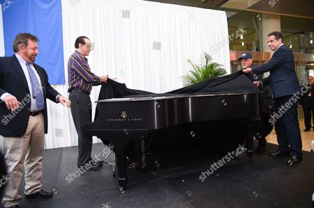 The Madison Square Garden Company executive chairman and CEO James L. Dolan, Chazz Palminteri, Billy Joel and New York Governor Andrew Cuomo unveil a piano that will be on display as a permanent tribute during a press conference to celebrate Billy Joel's 100th lifetime concert at Madison Square Garden on in New York