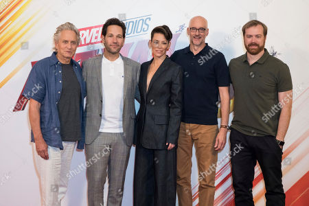 Actors Michael Douglas, from left, Paul Rudd, Evangeline Lilly, director Peyton Reed and producer Stephen Broussard pose for photographers during a photo call to promote the film 'Ant-Man and the Wasp', in London