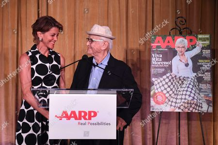 Wendie Malick, left, and honoree Norman Lear are seen on stage at the first-ever AARP TV for Grownups Honors at the Sunset Tower Hotel on in Los Angeles