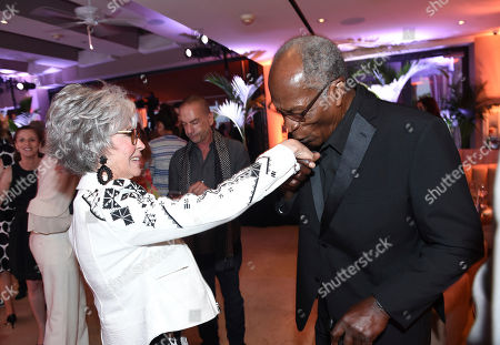 Rita Moreno, left, and John Amos attend the first-ever AARP TV for Grownups Honors at the Sunset Tower Hotel on in Los Angeles