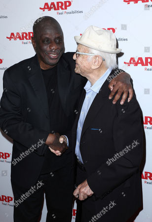 Jimmie Walker, left, and honoree Norman Lear attend the first-ever AARP TV for Grownups Honors at the Sunset Tower Hotel on in Los Angeles