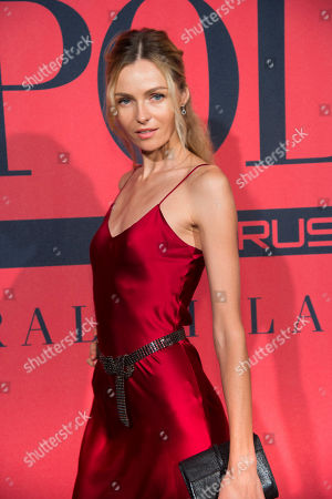 Stock Image of Valentina Zelyaeva attends a Ralph Lauren Fragrances private event hosted with Ansel Elgort at Manhattan Classic Car Club, in New York