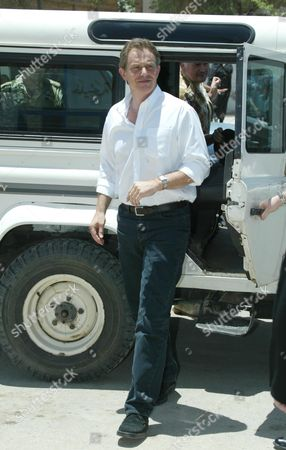 Action Man Prime Minister Tony Blair Alights A Landrover As He Arrives At The Khadija Alkobra Girls School In The Southern Iraq Town Of Basra. See Ross Benson Story.