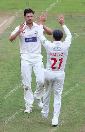 Craig Meschede of Glamorgan celebrates with Andrew Salter a successful appeal to take the wicket of Paul Collingwood.