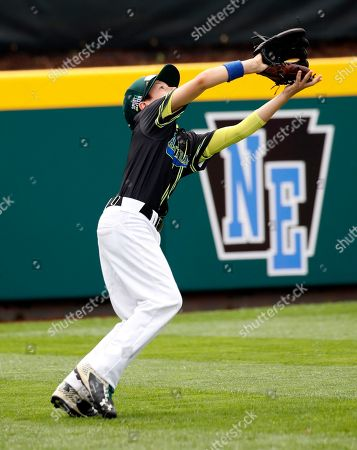 Australia's left fielder Jake Scott (3) makes a catch of a ball hit by Coventry, Rhode Island in the second inning of an consolation baseball game at the Little League World Series baseball tournament in South Williamsport, Pa., . Coventry, Rhode Island won the game 15-0