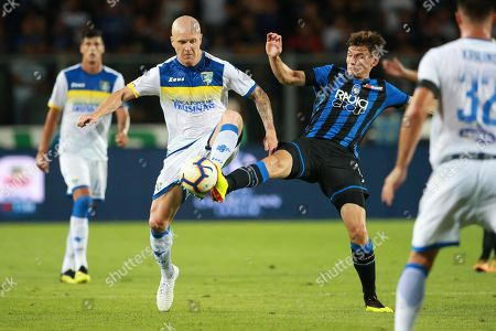 Stock Photo of Atalanta's Marten De Roon (R) and Frosinone's Emil Hallfredsson in action during the Italian Serie A soccer match Atalanta BC vs Frosinone Calcio at Atleti Azzurri d'Italia stadium in Bergamo, Italy, 20 August 2018.