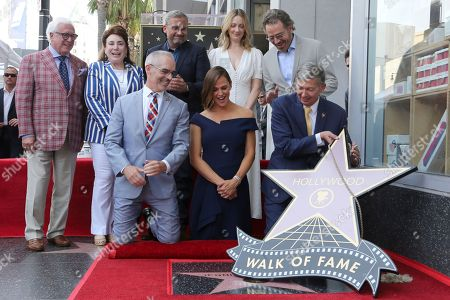 Television Producer Vin Di Bona, from left, Chair of the Hollywood Chamber of Commerce Donelle Dadigan, Los Angeles Councilman Mitch O' Farrell, Steve Carell, Jennifer Garner, Judy Greer, Leron Gubler and Bryan Cranson unveil the star at the ceremony honoring Jennifer Garner with a star at the Hollywood Walk of Fame, in Los Angeles