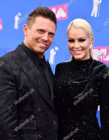 Mike Mizanin, Maryse Ouellet. Mike 'The Miz' Mizanin, left, and Maryse Ouellet arrive at the MTV Video Music Awards at Radio City Music Hall, in New York