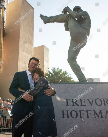 Stock Picture of Former San Diego Padres pitcher Trevor Hoffman, left, embraces with his mother, Mikki, as they celebrate unveiling ceremony of his statue before a baseball game between the San Diego Padres and the Arizona Diamondbacks in San Diego