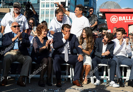 Former San Diego Padres pitcher Trevor Hoffman, center, gets emotional as his statue is being unveiled before a baseball game between the San Diego Padres and Arizona Diamondbacks in San Diego