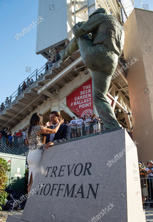 Former San Diego Padres pitcher Trevor Hoffman, right, and his wife Tracy celebrate the new statue of Hoffman before a baseball game between the San Diego Padres and the Arizona Diamondbacks in San Diego