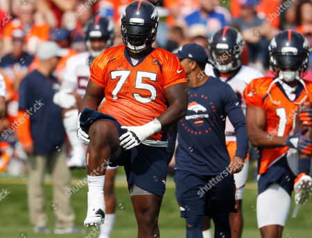 Denver Broncos offensive lineman Menelik Watson takes part in drills during the team's NFL football training camp in Englewood, Colo. The Broncos have placed the oft-injured lineman on the injured reserve list with a chest injury with the intent to release him once he's healthy