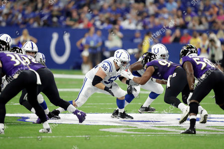 Indianapolis Colts offensive guard Quenton Nelson (56) blocks Baltimore Ravens defensive tackle Carl Davis (94) in the first half of an NFL preseason football game in Indianapolis