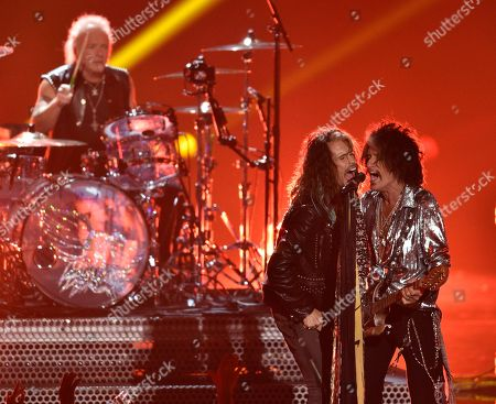 Joey Kramer, Steven Tyler, Joe Perry. Joey Kramer, from left, Steven Tyler and Joe Perry of Aerosmith perform at the MTV Video Music Awards at Radio City Music Hall, in New York