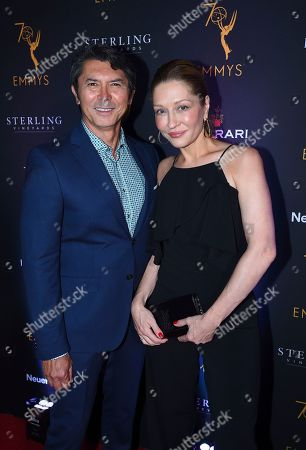 Lou Diamond Phillips, Yvonne Boismier Phillips. Lou Diamond Phillips, left, and Yvonne Boismier Phillips attend the Television Academy's 2018 Performers Peer Group Celebration of the 70th Emmy Awards at NeueHouse Hollywood, in Los Angeles