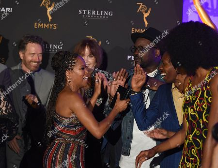 Bryan Cranston, Lee Garlington, Regina King, Brian Tyree Henry. Regina King, left, attends the Television Academy's 2018 Performers Peer Group Celebration of the 70th Emmy Awards at NeueHouse Hollywood, in Los Angeles