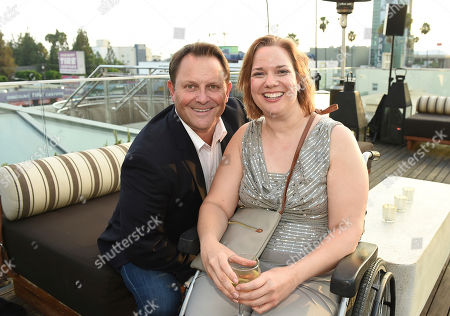 Kevin E. West, Dawn Grabowski. Kevin E. West, left, and Dawn Grabowski attend the Television Academy's 2018 Performers Peer Group Celebration of the 70th Emmy Awards at NeueHouse Hollywood, in Los Angeles