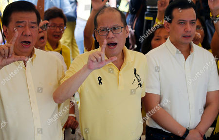 """Benigno Aquino III, Franklin Drilon, Antonio Trillanes IV. Former President Benigno Aquino III, center, flashes the """"L"""" sign meaning """"Fight!"""" as he leads the commemoration of the Aug. 21, 1983 Manila International Airport assassination of his father, opposition Senator Benigno Aquino Jr. at the Manila Memorial Park in suburban Paranaque east of Manila, Philippines . Aquino Jr.'s assassination sparked series of protest that eventually toppled the late dictator Ferdinand Marcos from 20-year-rule and helped install his widow Corazon """"Cory"""" Aquino to the presidency via People Power revolt. At left is opposition Senator Franklin Drilon and at right is another opposition Senator Antonio Trillanes IV"""